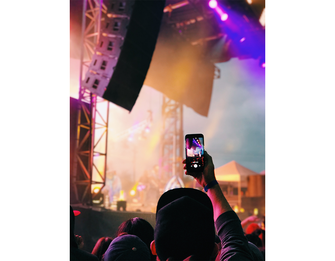 pink and purple lighting at a concert outdoors