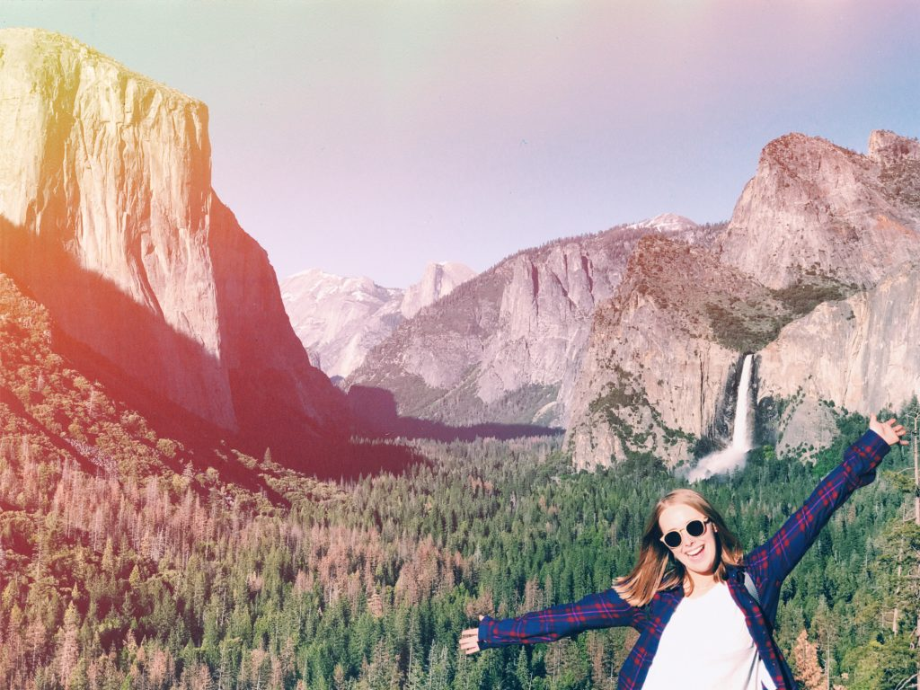 Mackenzie standing in front of mountains