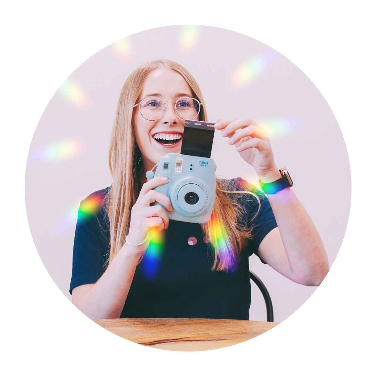 blonde girl holding a polaroid camera